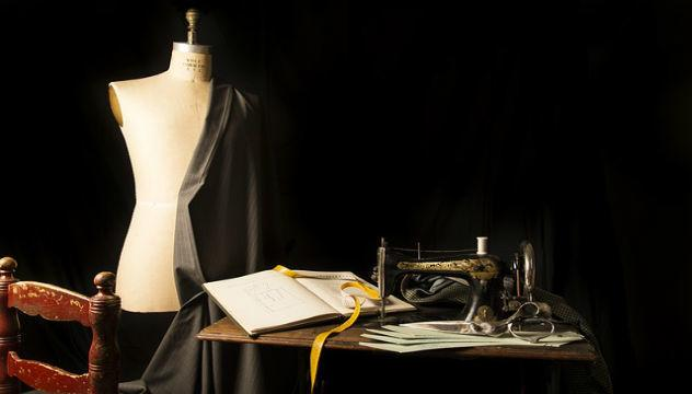 a mannequin and sewing machine in a tailors