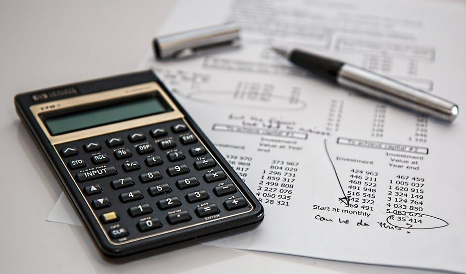 calculator with financial document