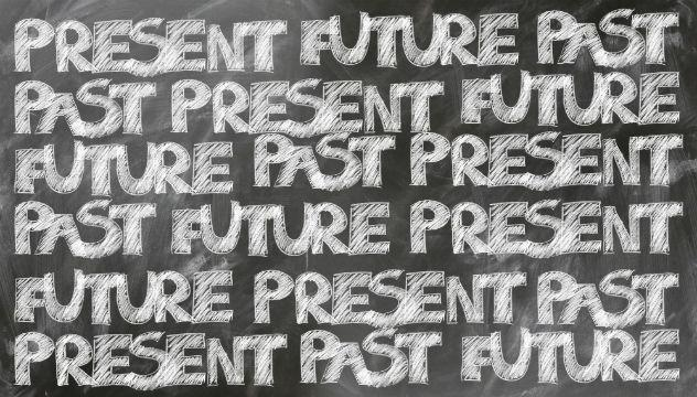 3 tenses past future and present written on a blackboard