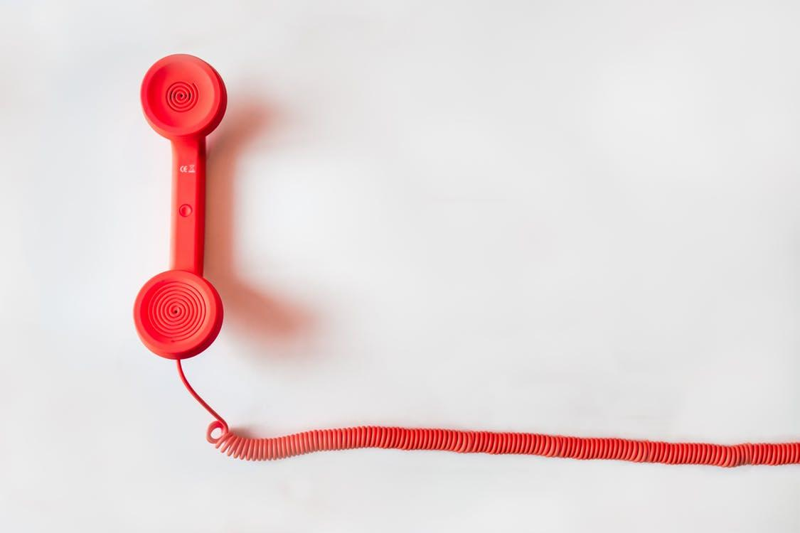 old red phone on a white background