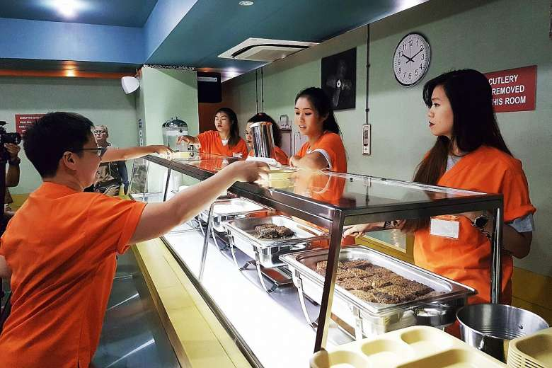 Prison Themed Restaurant Everyone Is Wearing Orange