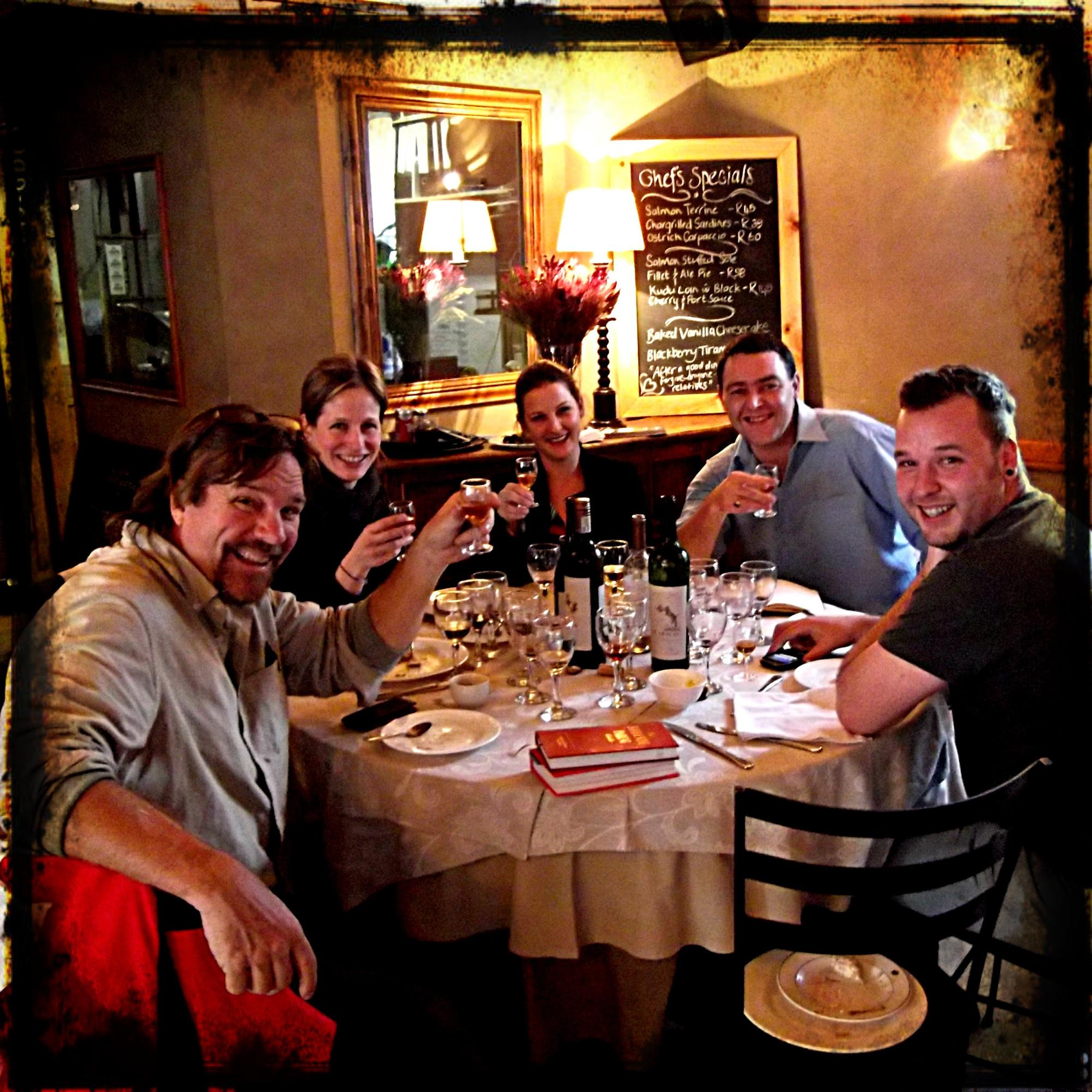 A Group of Friends Tasting Wine at a Restaurant