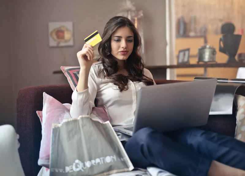 woman purchasing something online whilst using a loyalty program