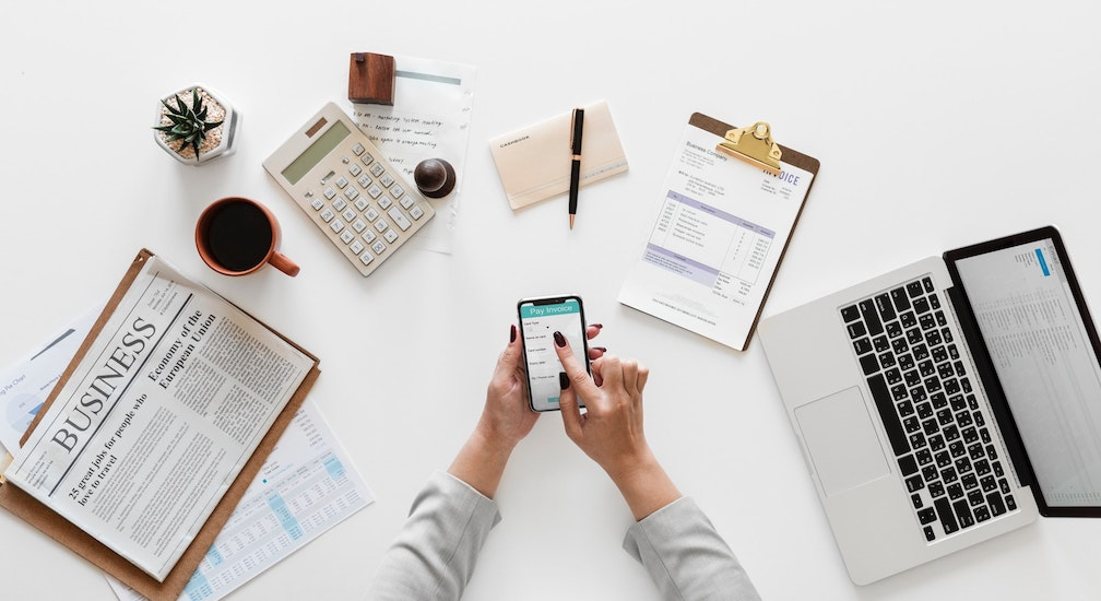 woman managing finances with phone