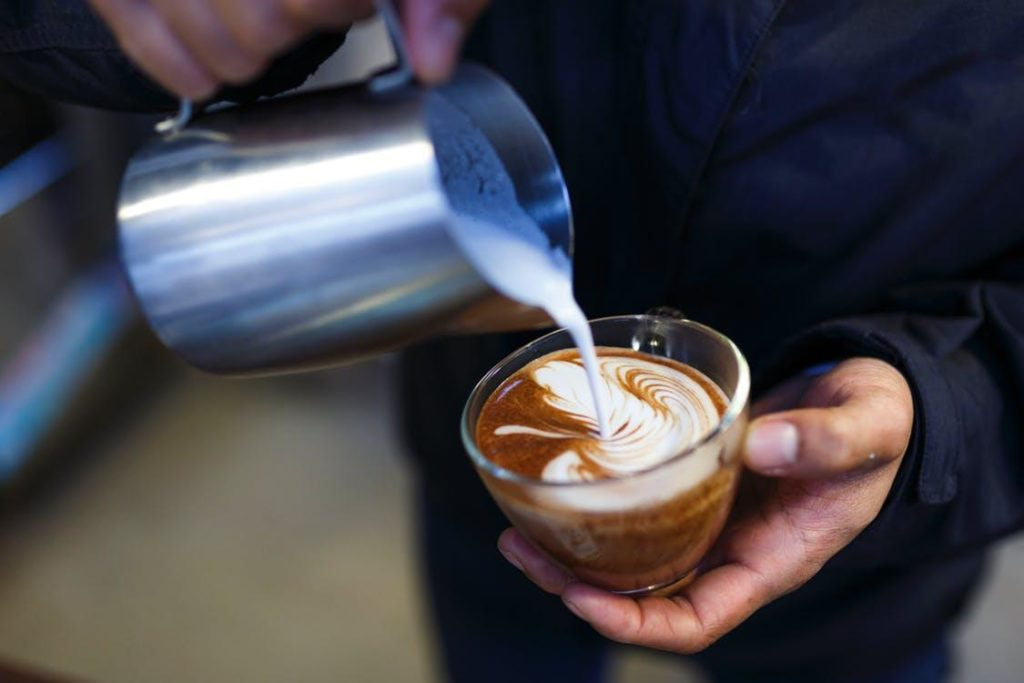 barista making latte