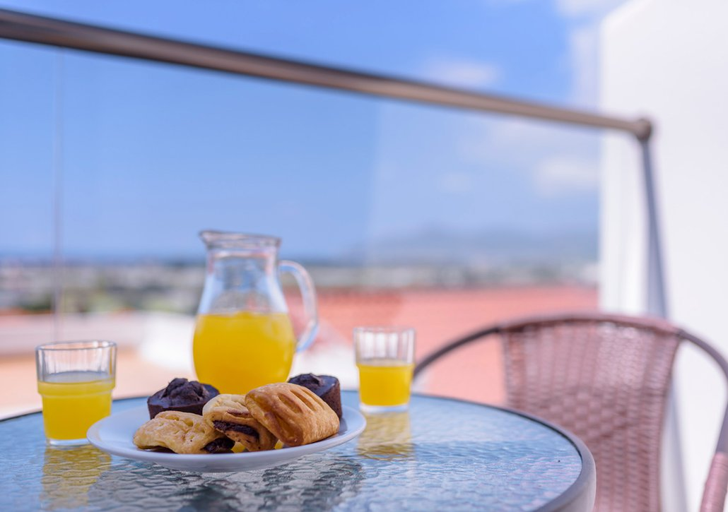 Breakfast on plate from our buffet on the balcony of your room