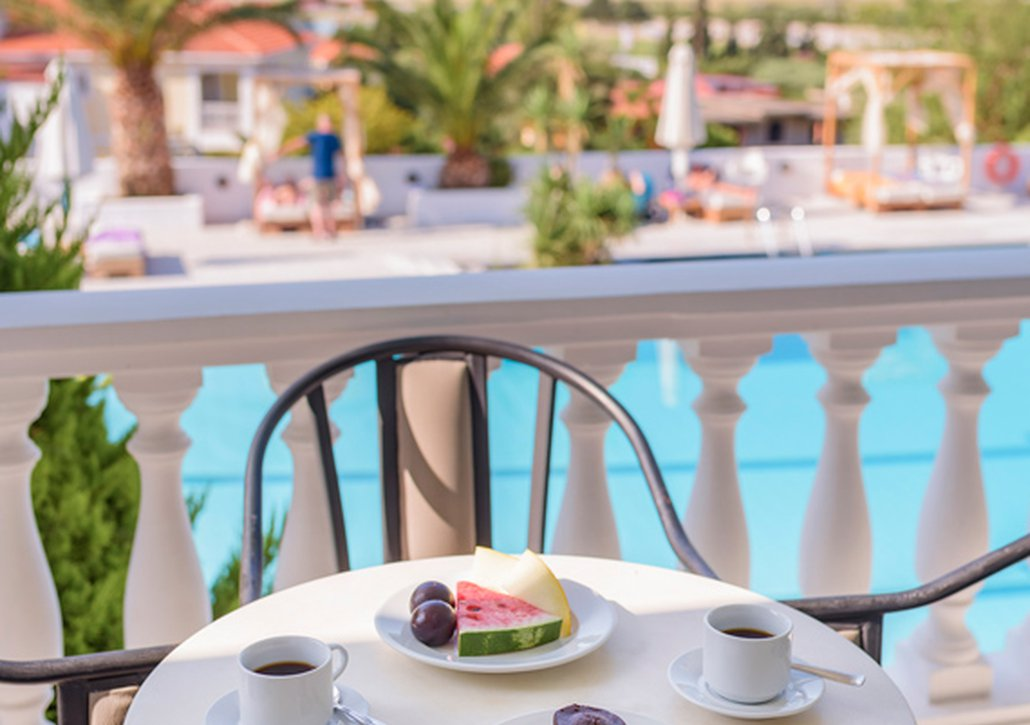 Breakfast from our buffet on the balcony of the room looking at the pool