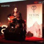 Craig Green performing on his Teton Classical Guitar at TEDx Idaho Falls