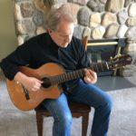 Teton Guitarist Mike Christiansen playing his Classical Teton Guitar