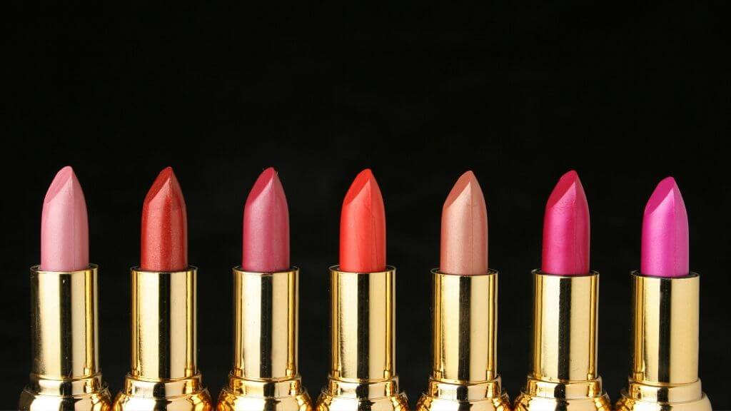 A collection of different colored lipsticks.