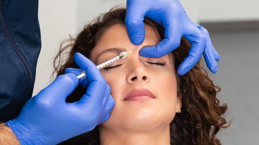 A woman receiving Botox treatment