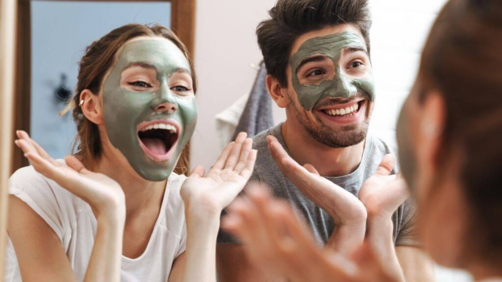 A couple applying face masks