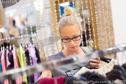 Blond woman shopping
