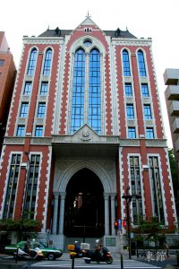 the gothic front gate of keio university's mita campus