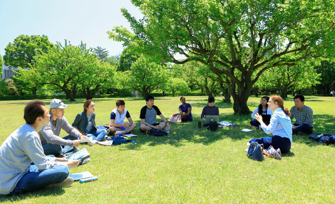 Students learning on the grass in international Christian University