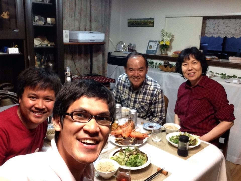 A student has fun eating dinner with his host family.