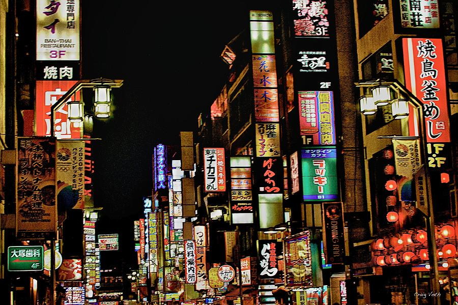 Bright street signs in night-time Tokyo.