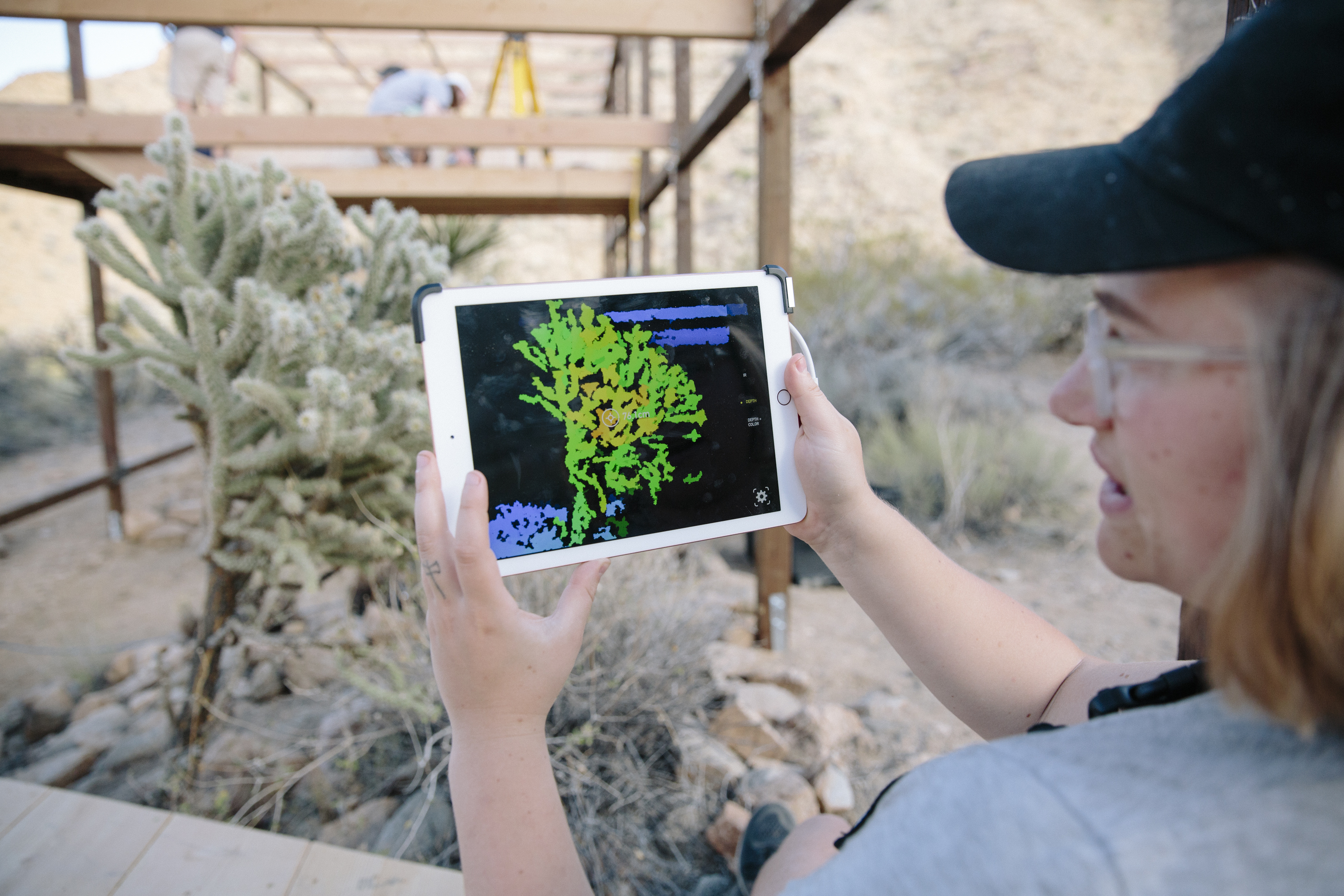 student using AR technology to represent plant realtimet ipad