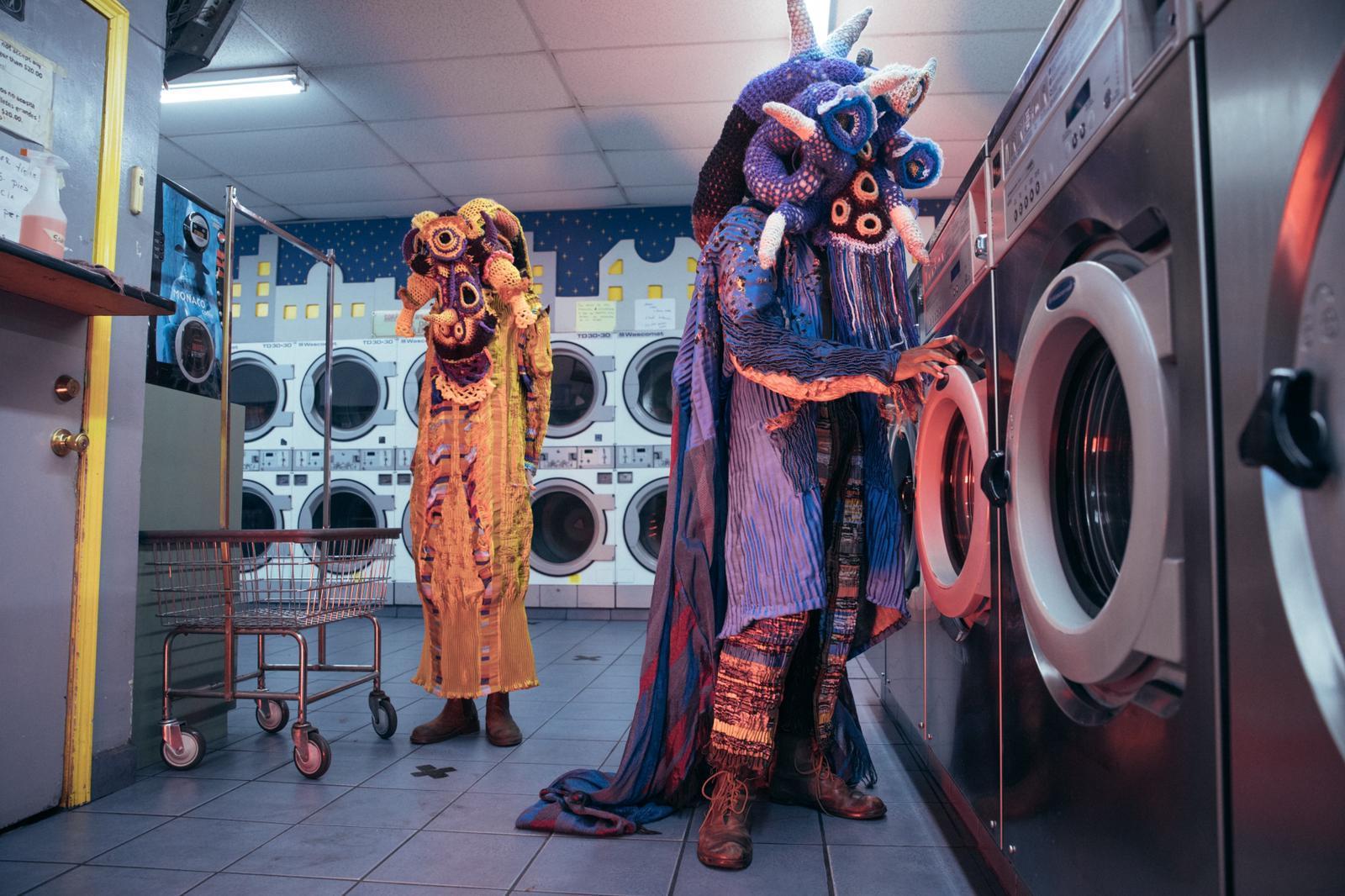 figures colorful costume laundromat