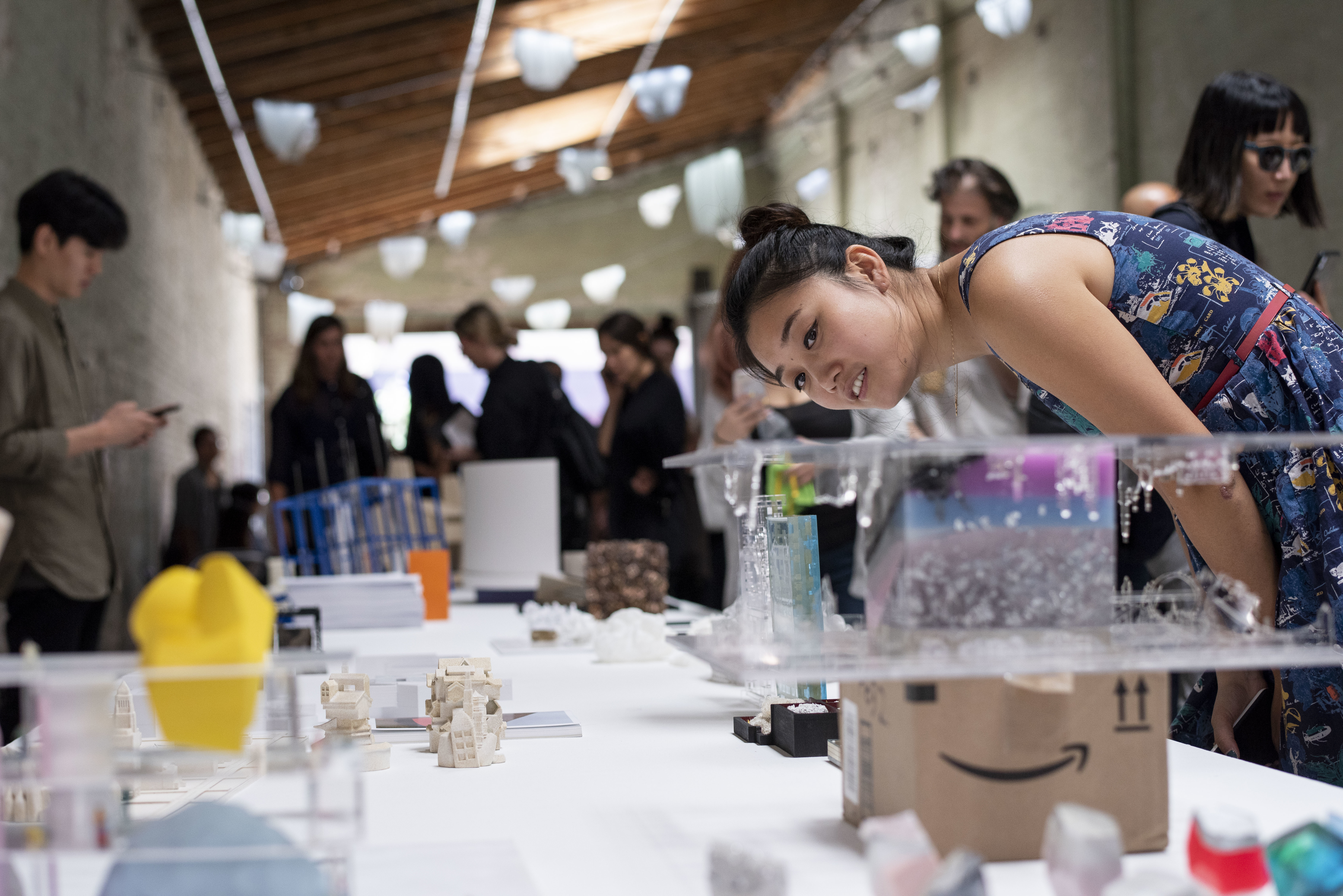 architecture enthusiast closely inspecting miniature thesis model