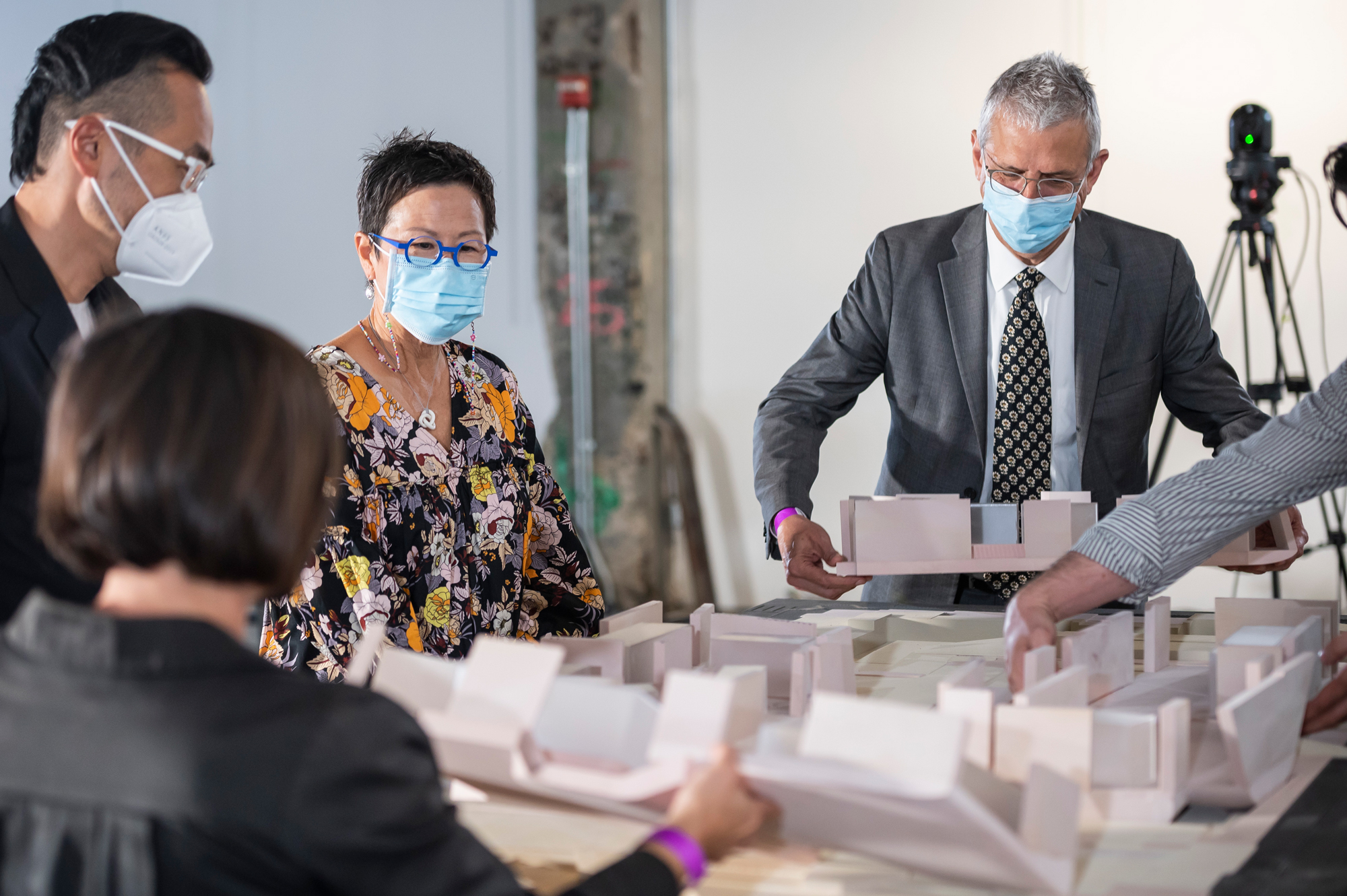 people looking at architecture models