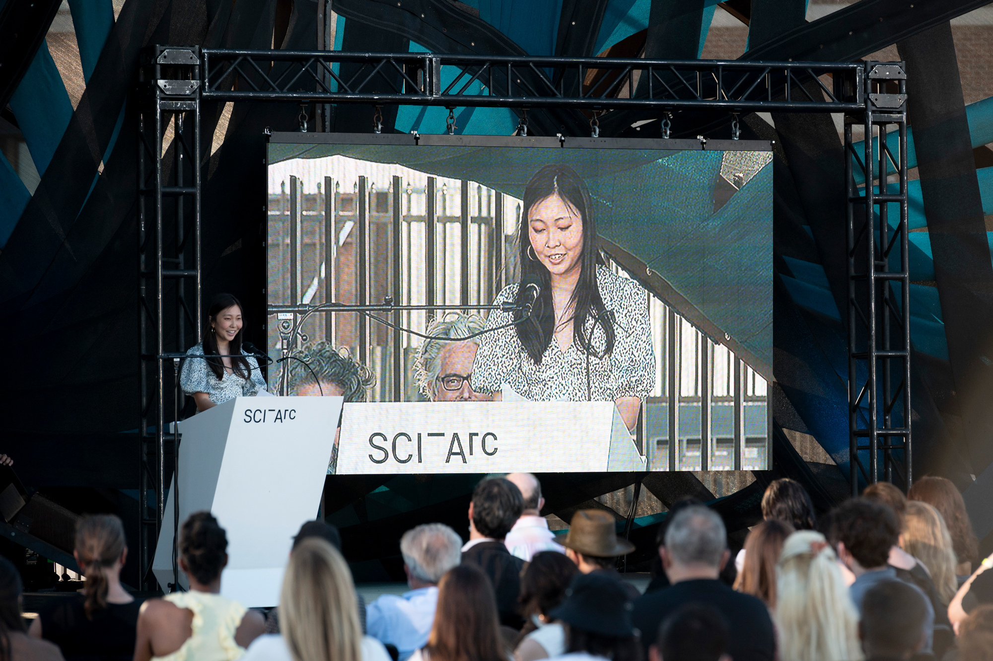 speech screen crowd podium