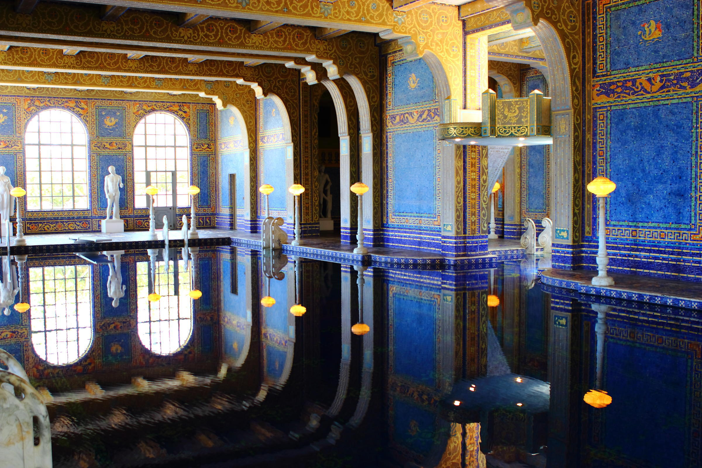 pool blue walls tile arches
