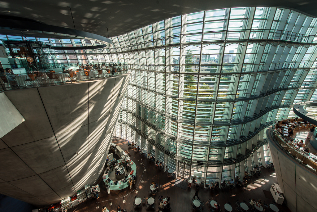 curved glass facade building interior mezzanine shot