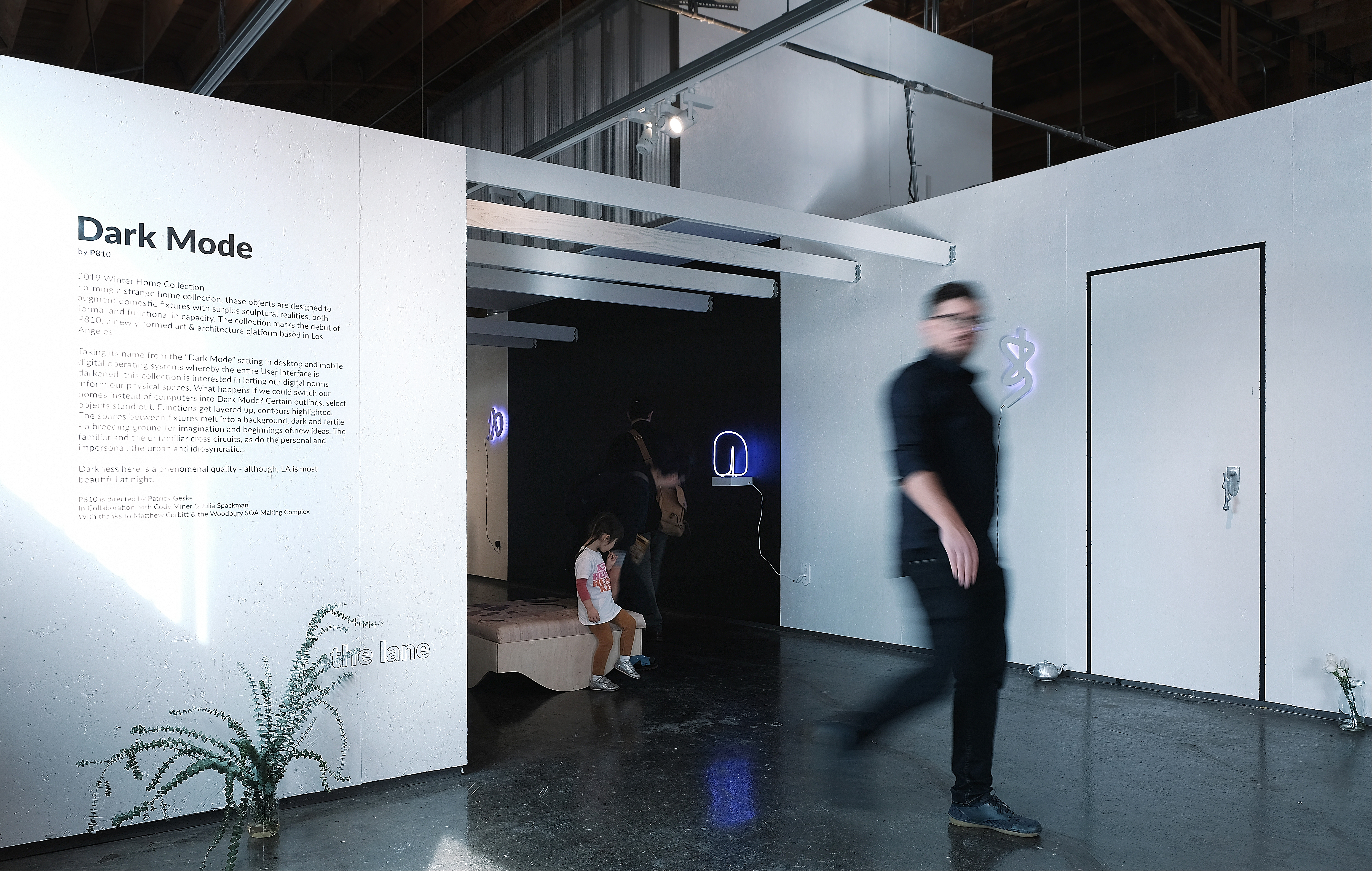 people visiting the Dark Mode exhibit at A+D museum