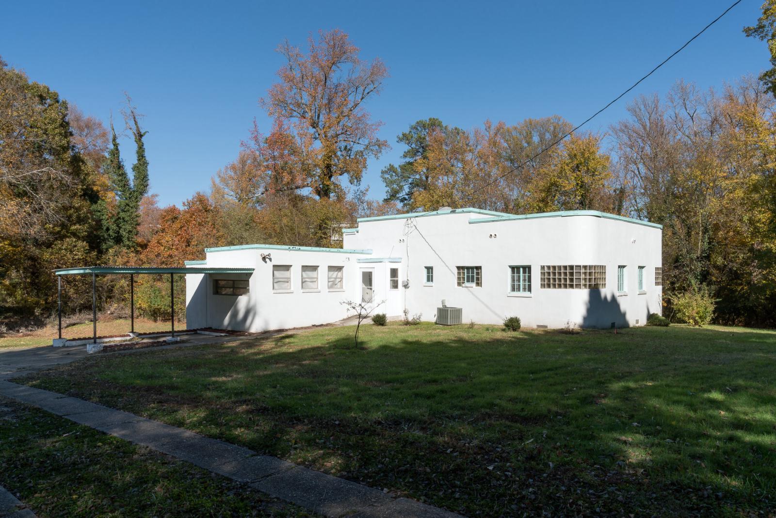 white modern house yard trees