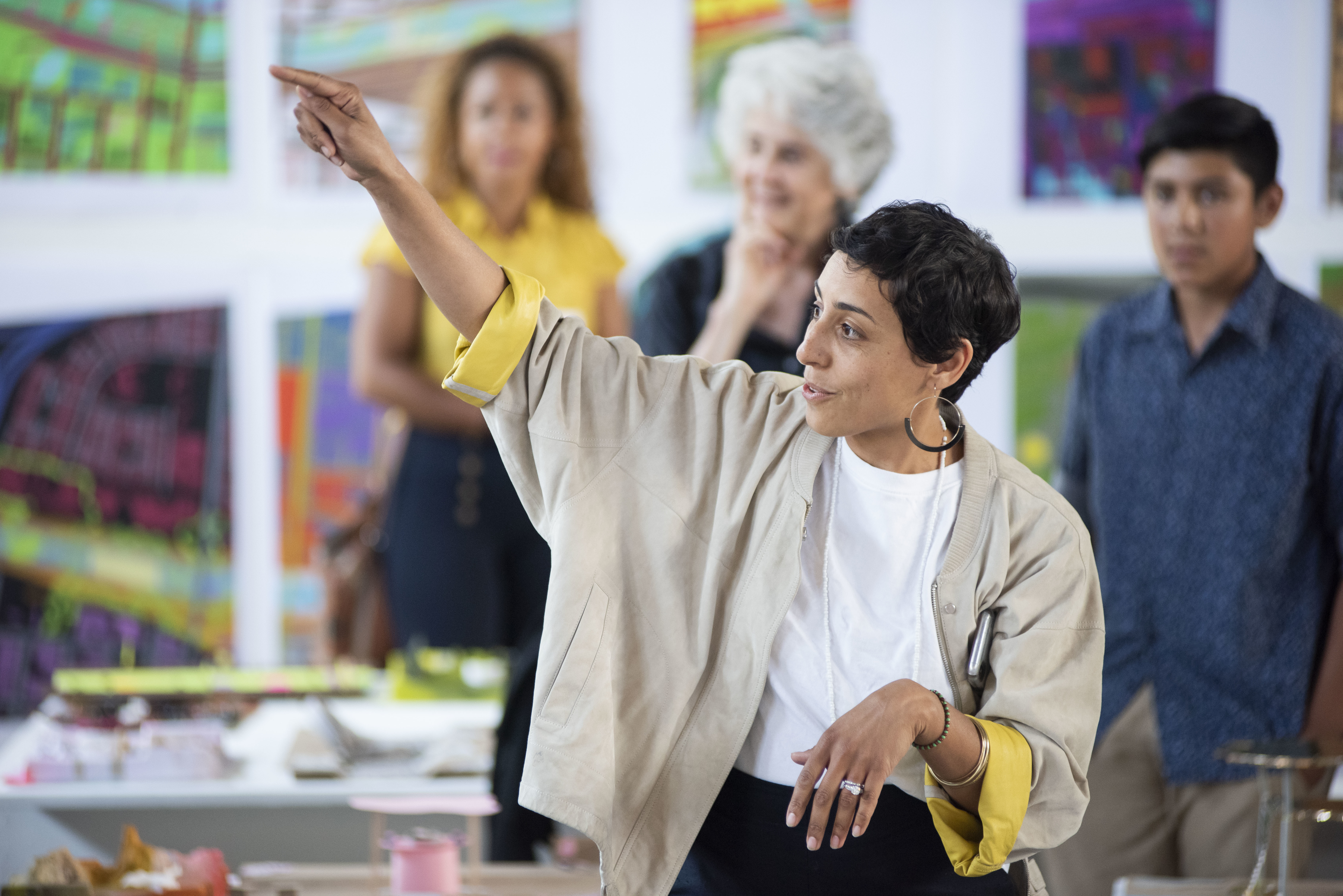 Mira Henry teaching in exhibition