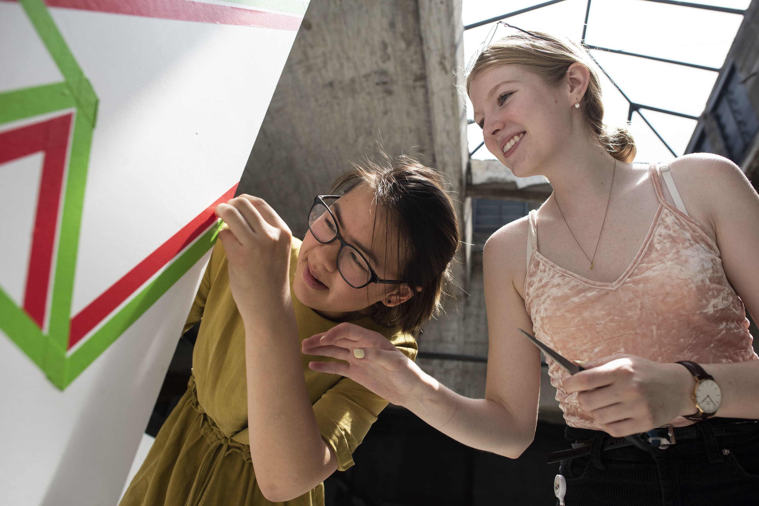 two girls working on an architectural model