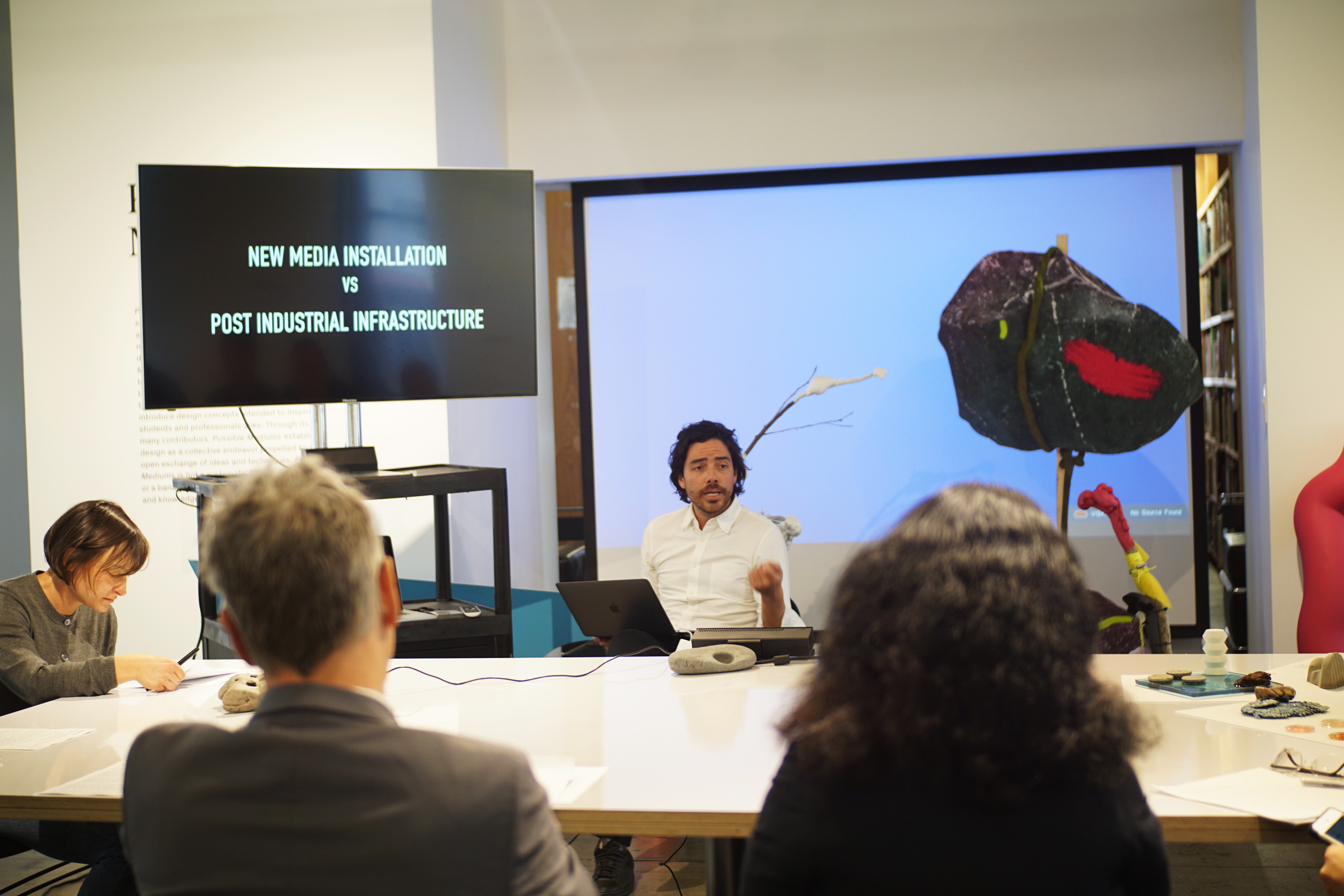 A sciarc student presenting his project to SCI-Arc faculties