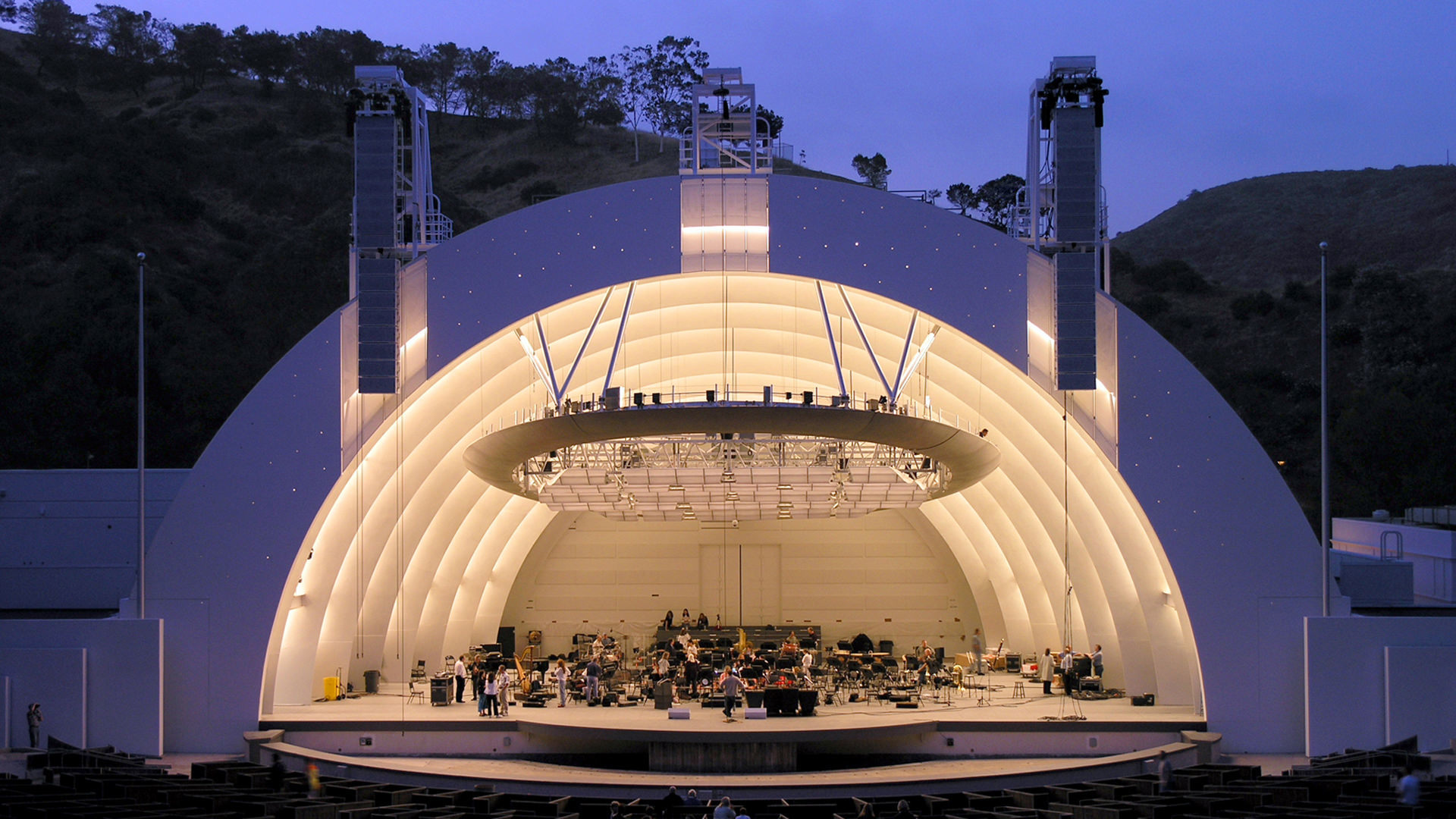 a semicircular stage dome like structure with orchestra on stage