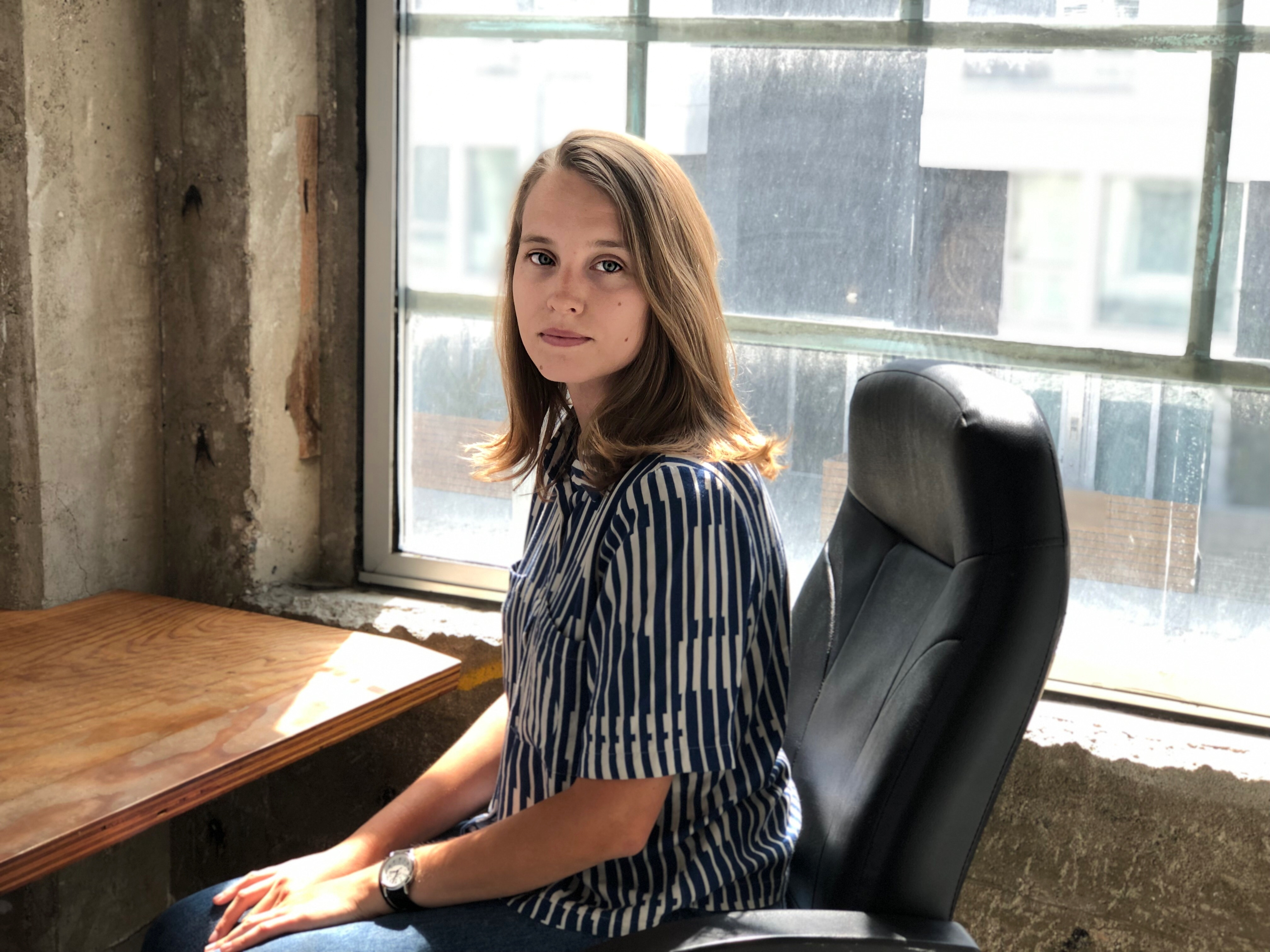 girl sitting desk window