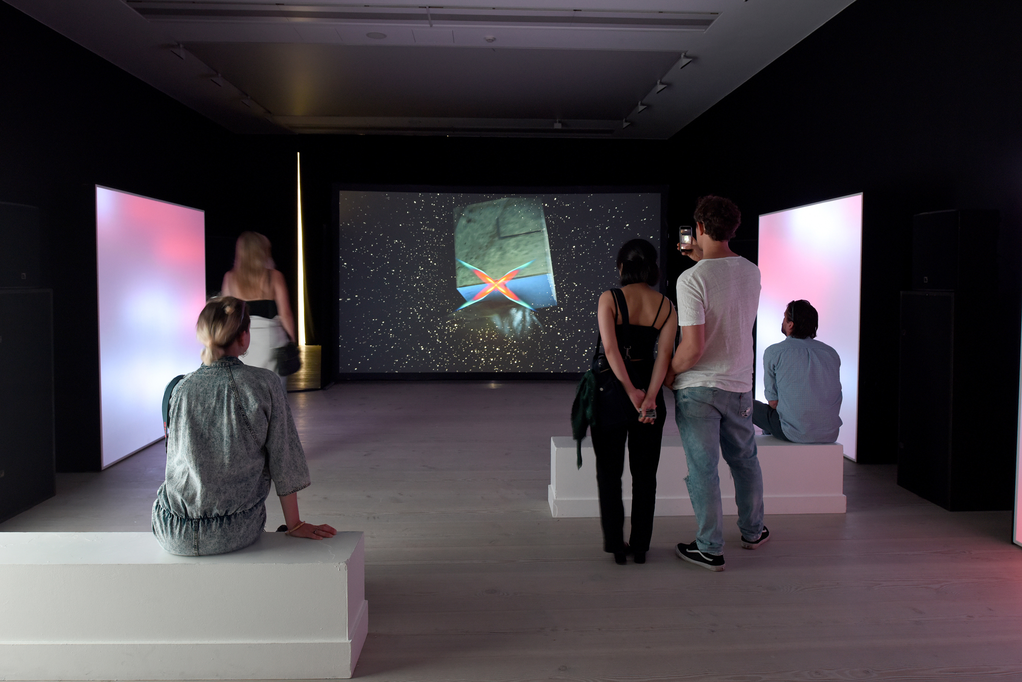 people in a video exhibition