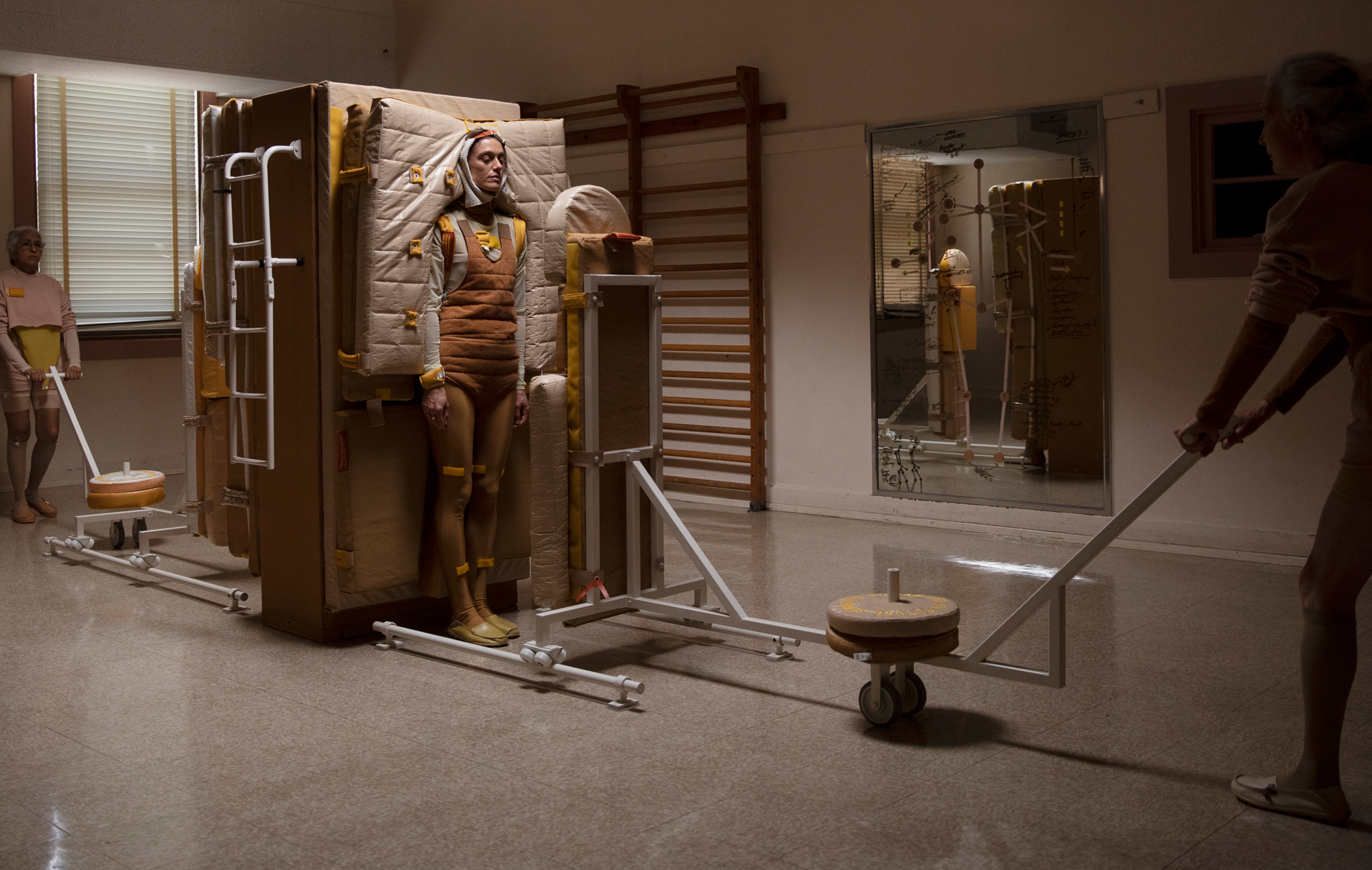 person brown cushion machine installation