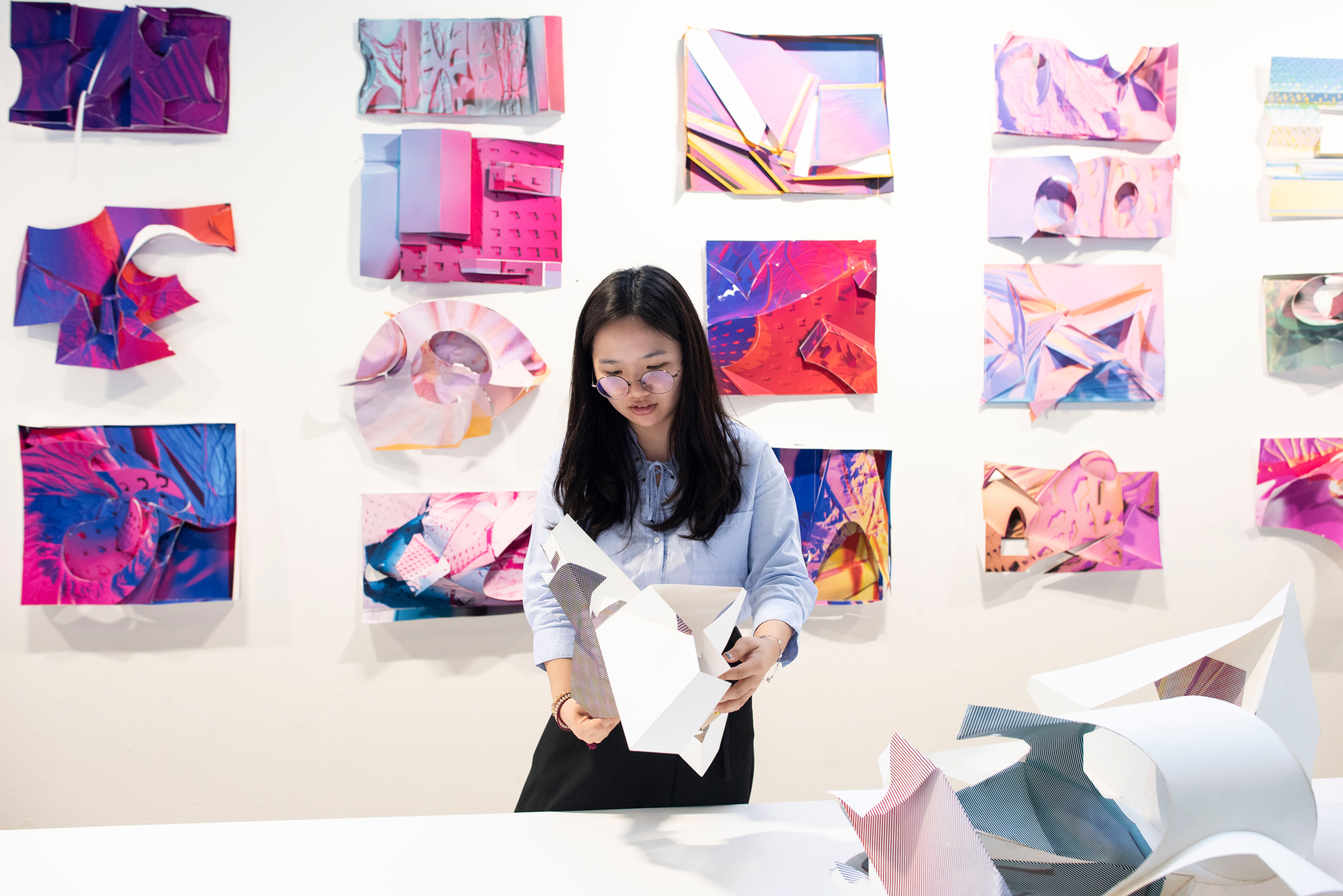 student holding project colorful exhibition