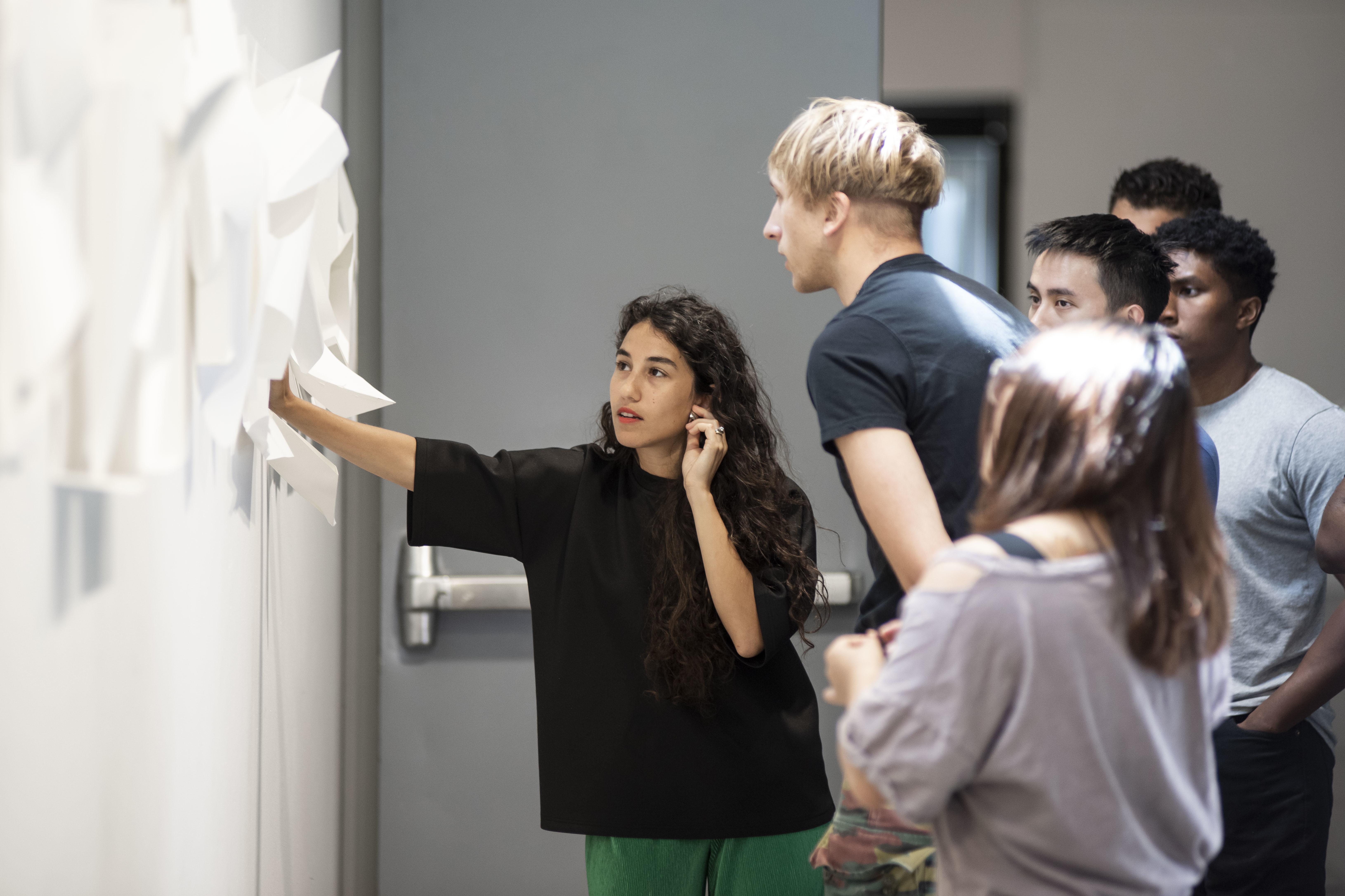 zeina koreitem discussing with students
