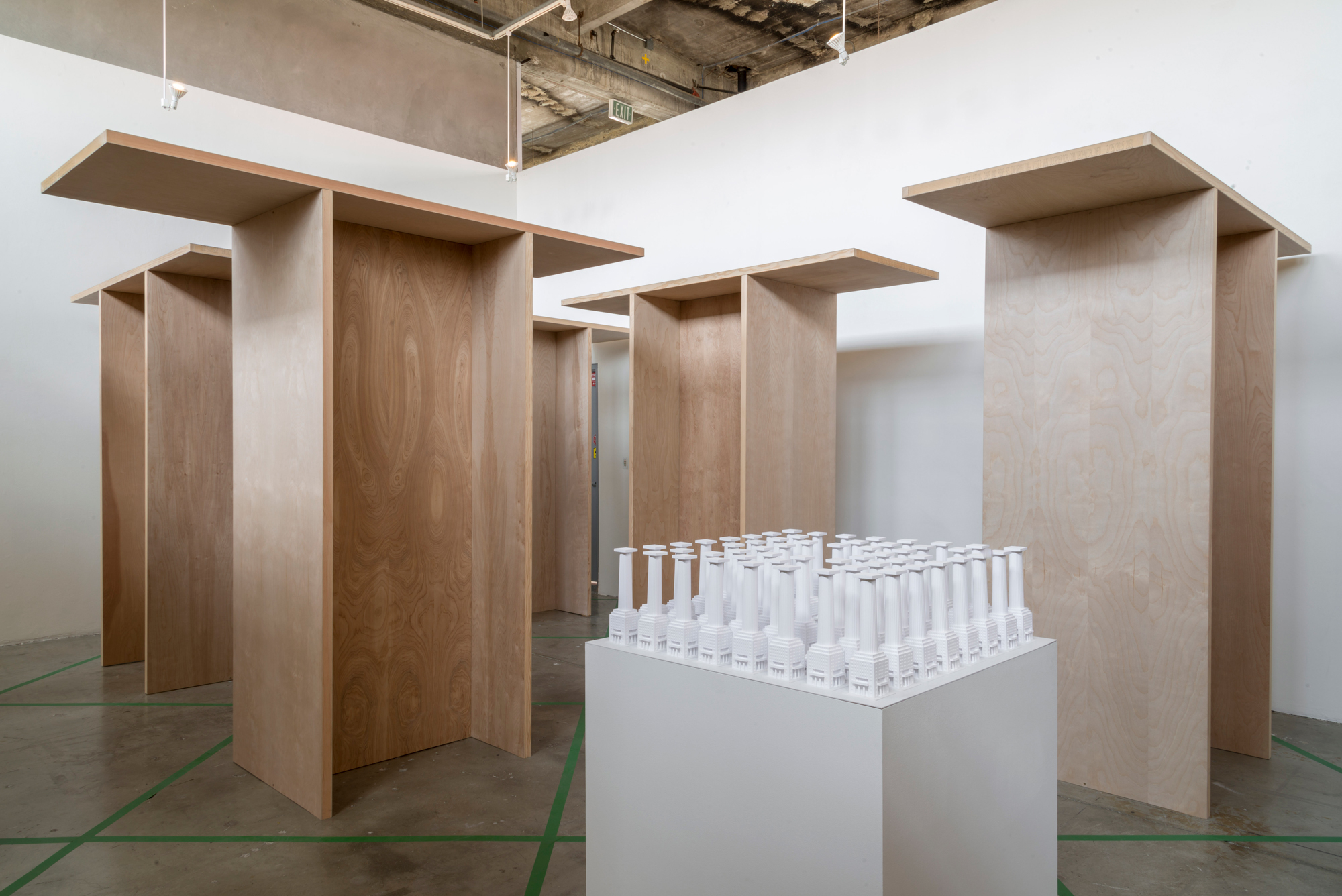 white architecture model in wooden structures art exhibition