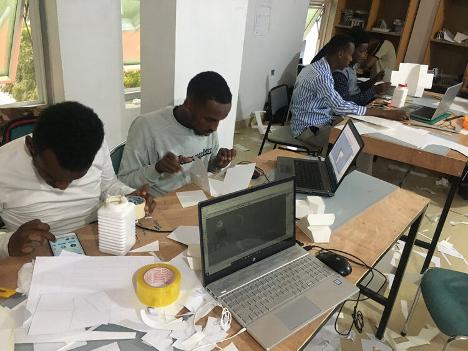 students working desks computer