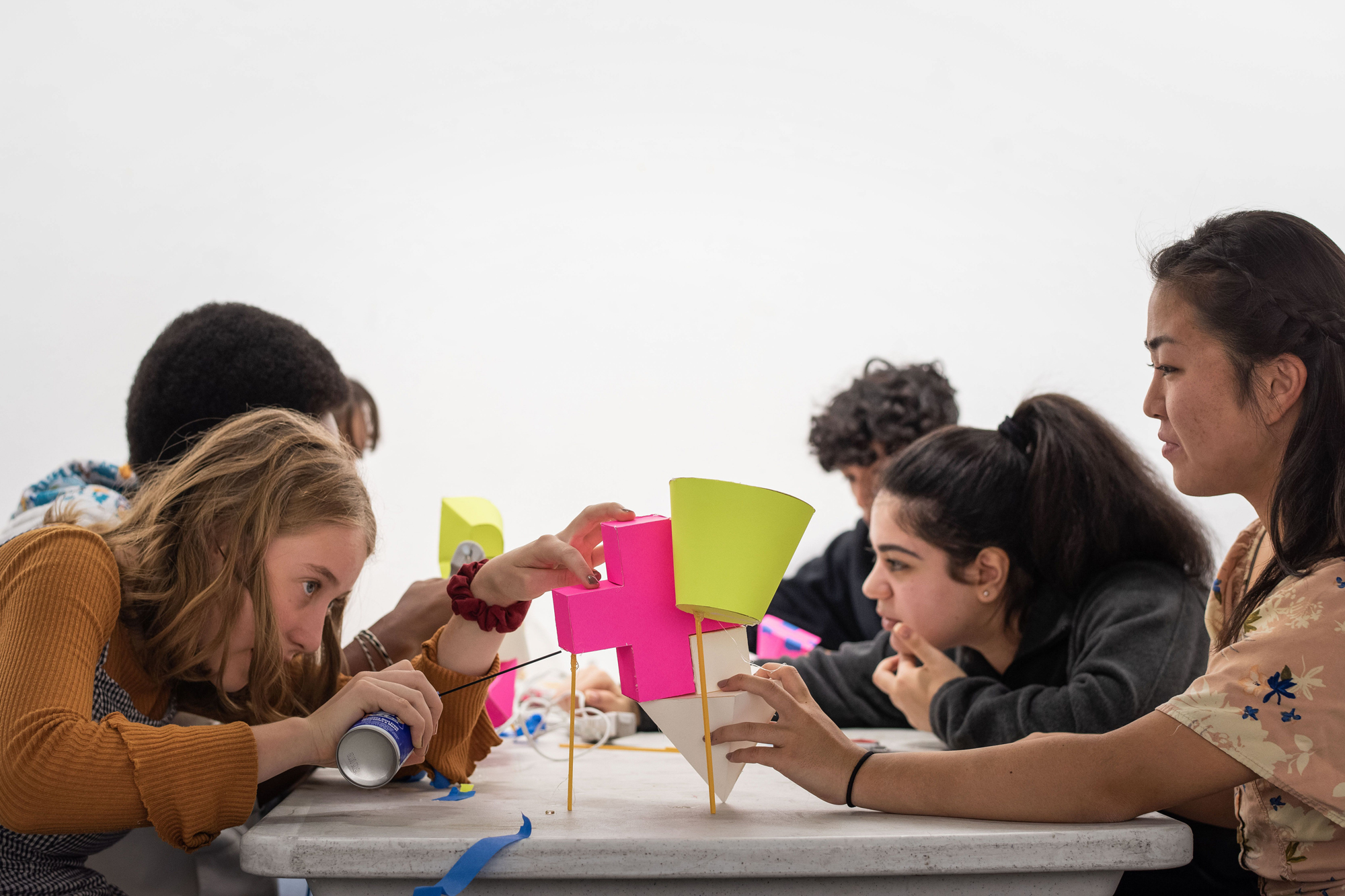 students sitting at table crafts