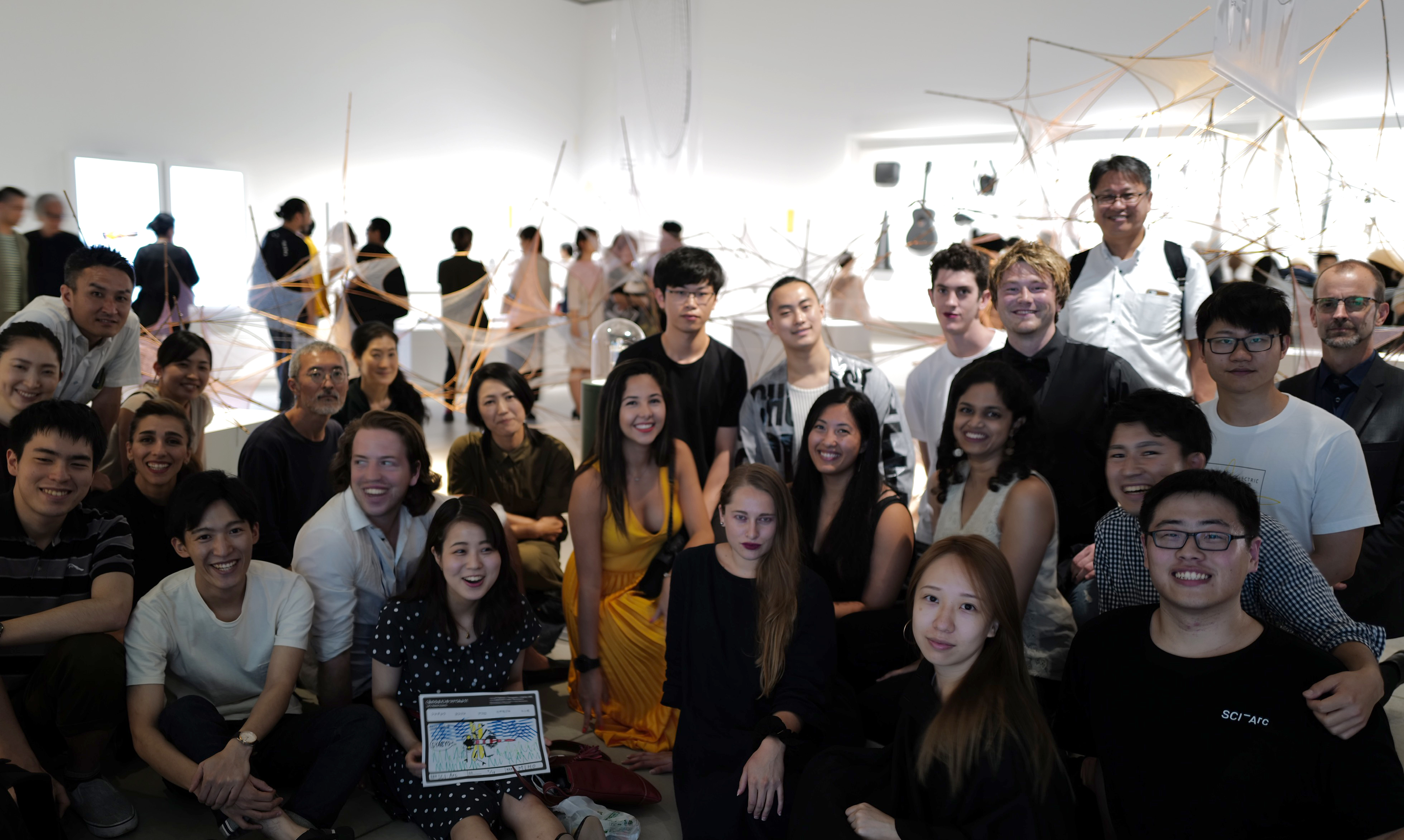 student group photo at exhibition opening