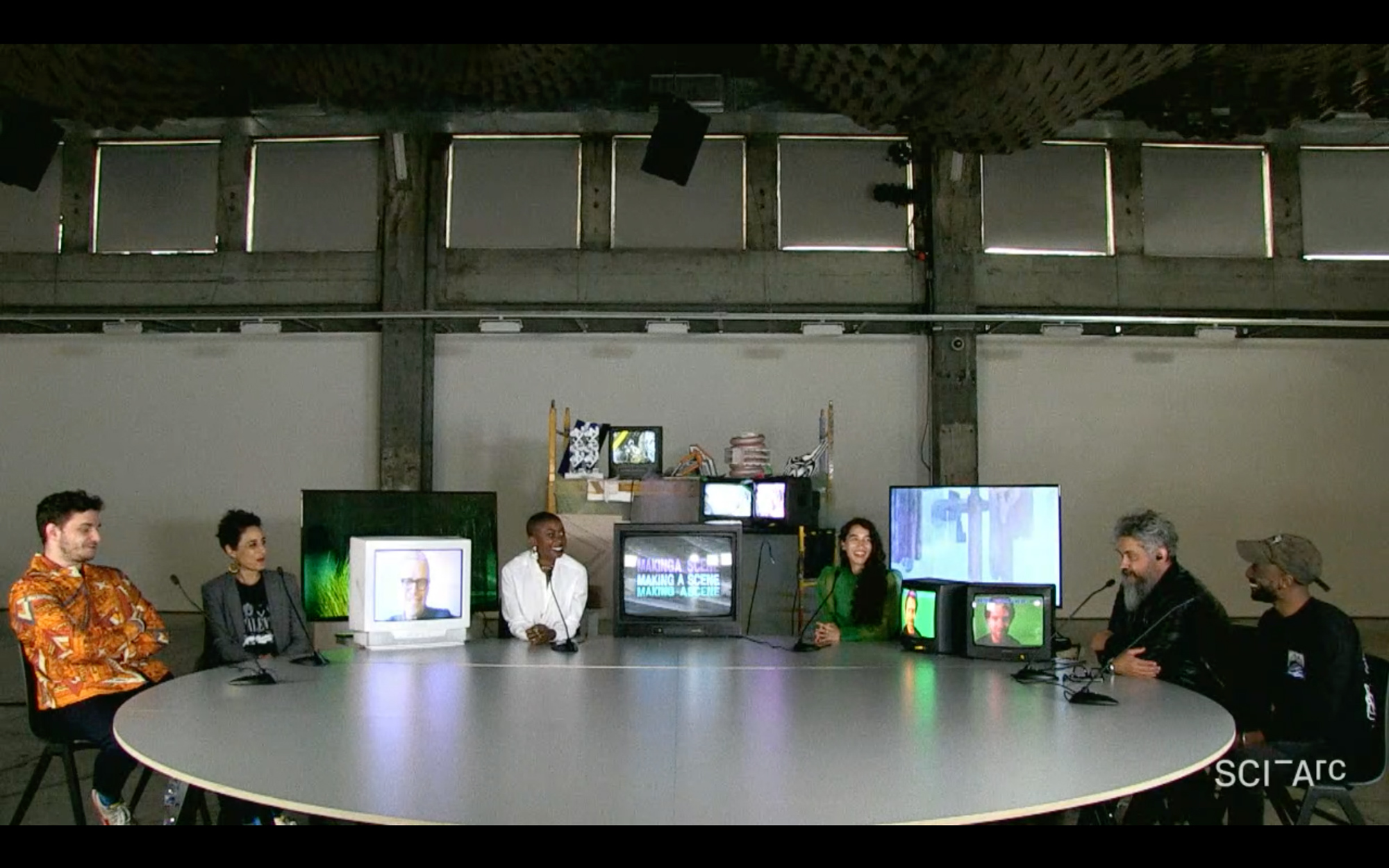 people round table tv screens