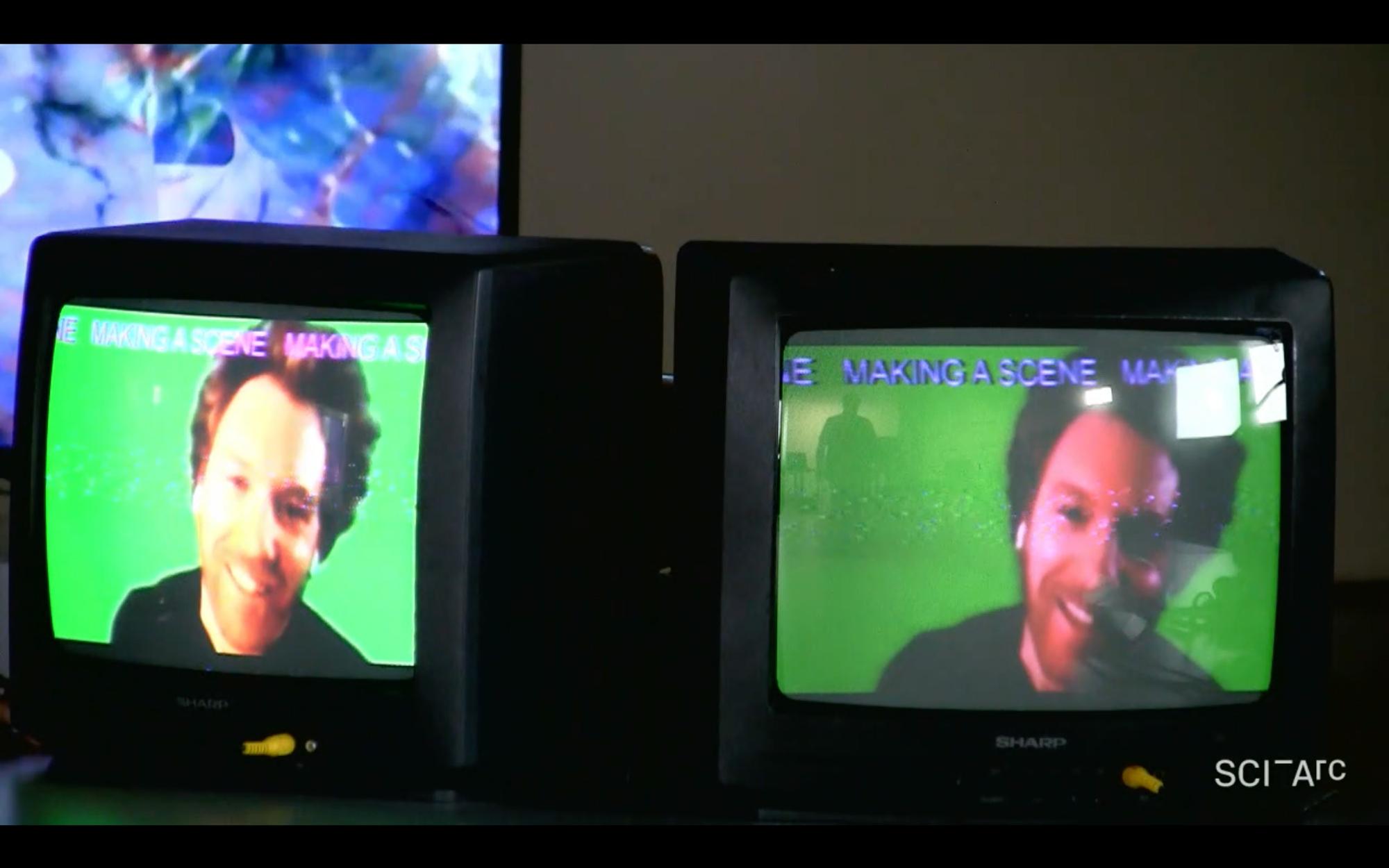 two screens man smiling green screen