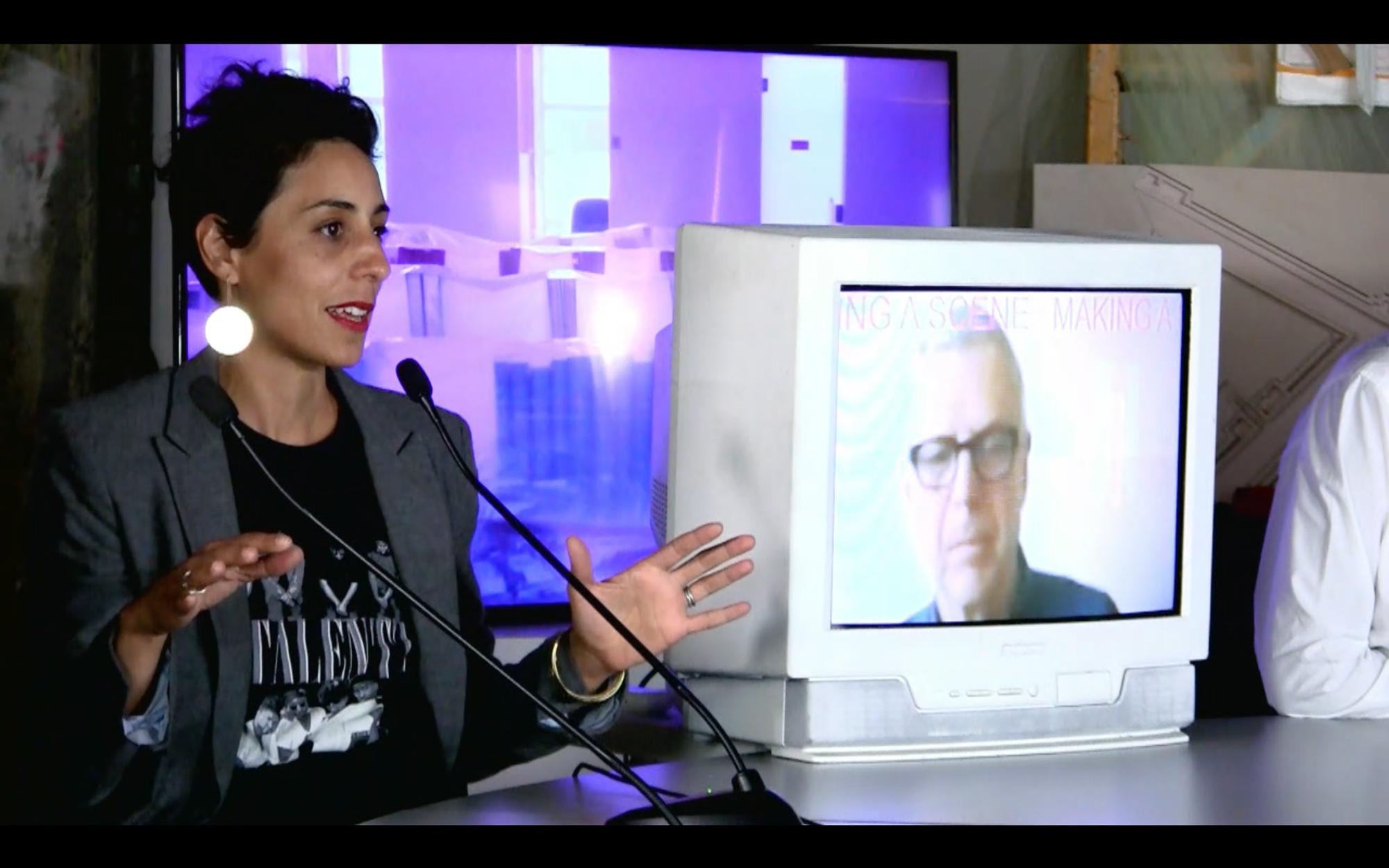 woman speaking man on tv screen