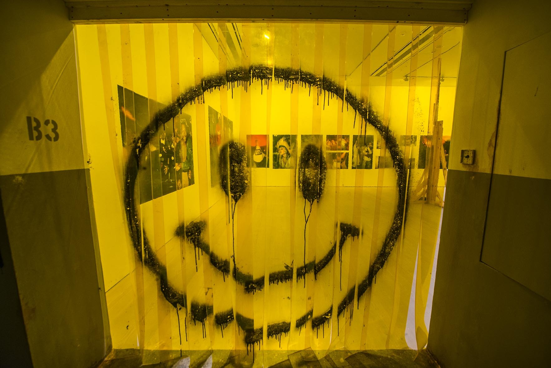 Saatchi gallery yellow curtain smiley face art