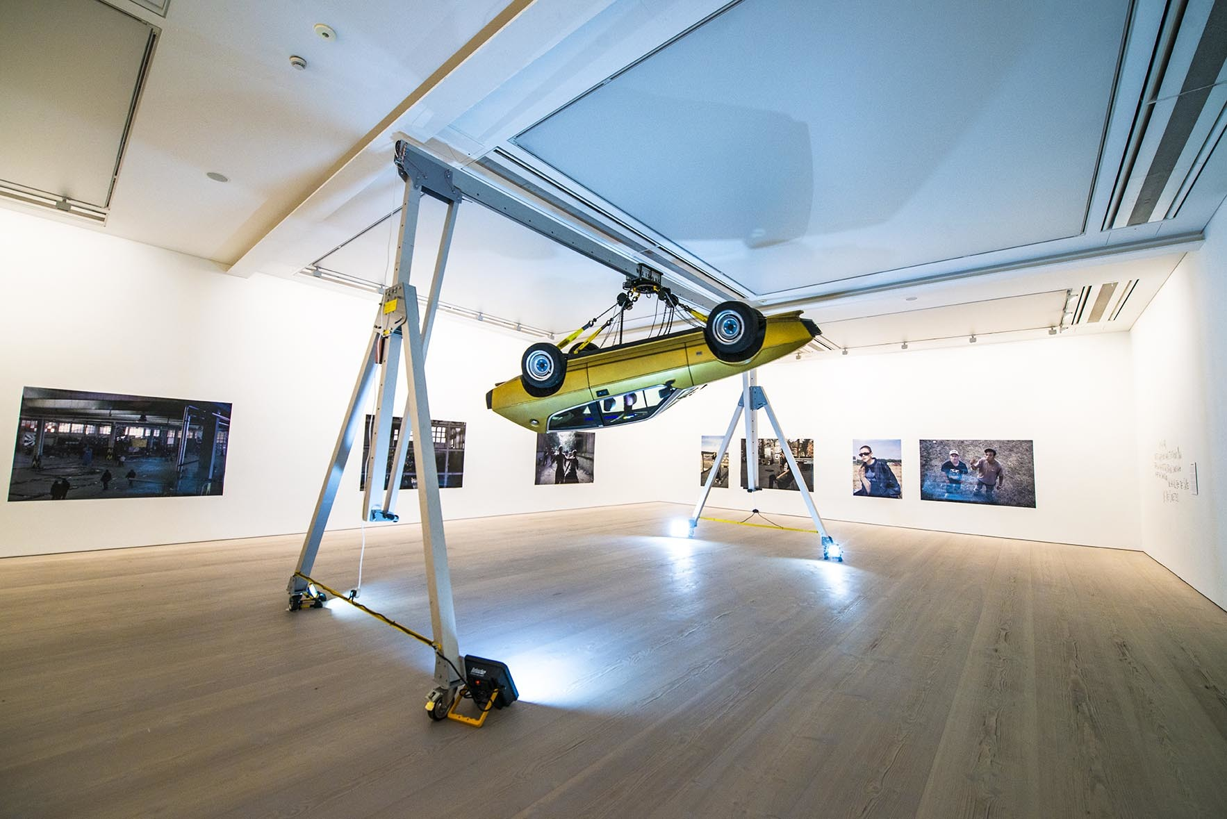 Saatchi gallery car hangs in room