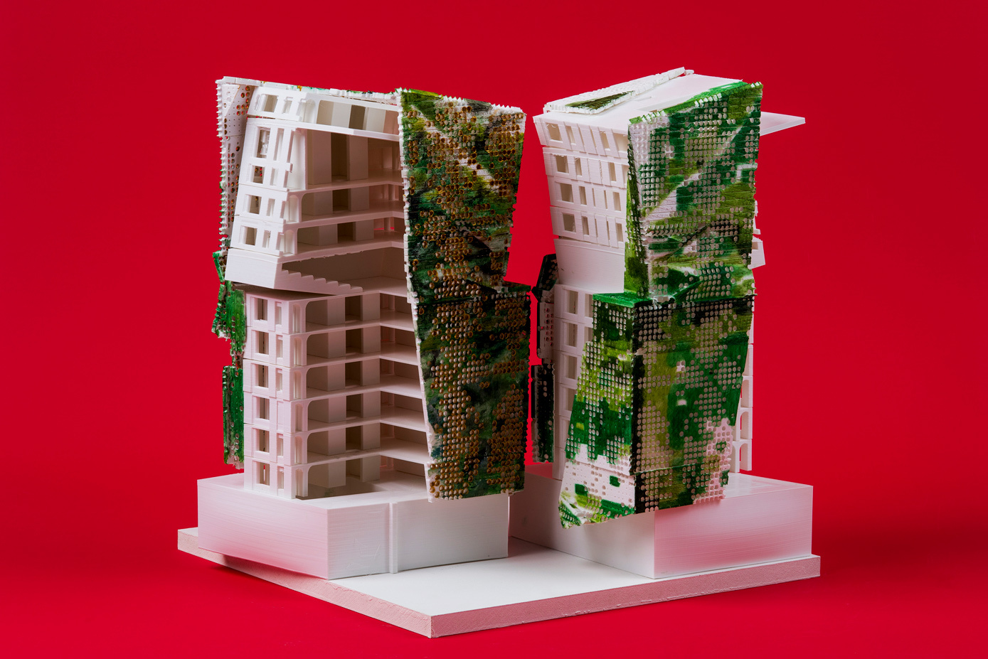 architecture model white with green side red background