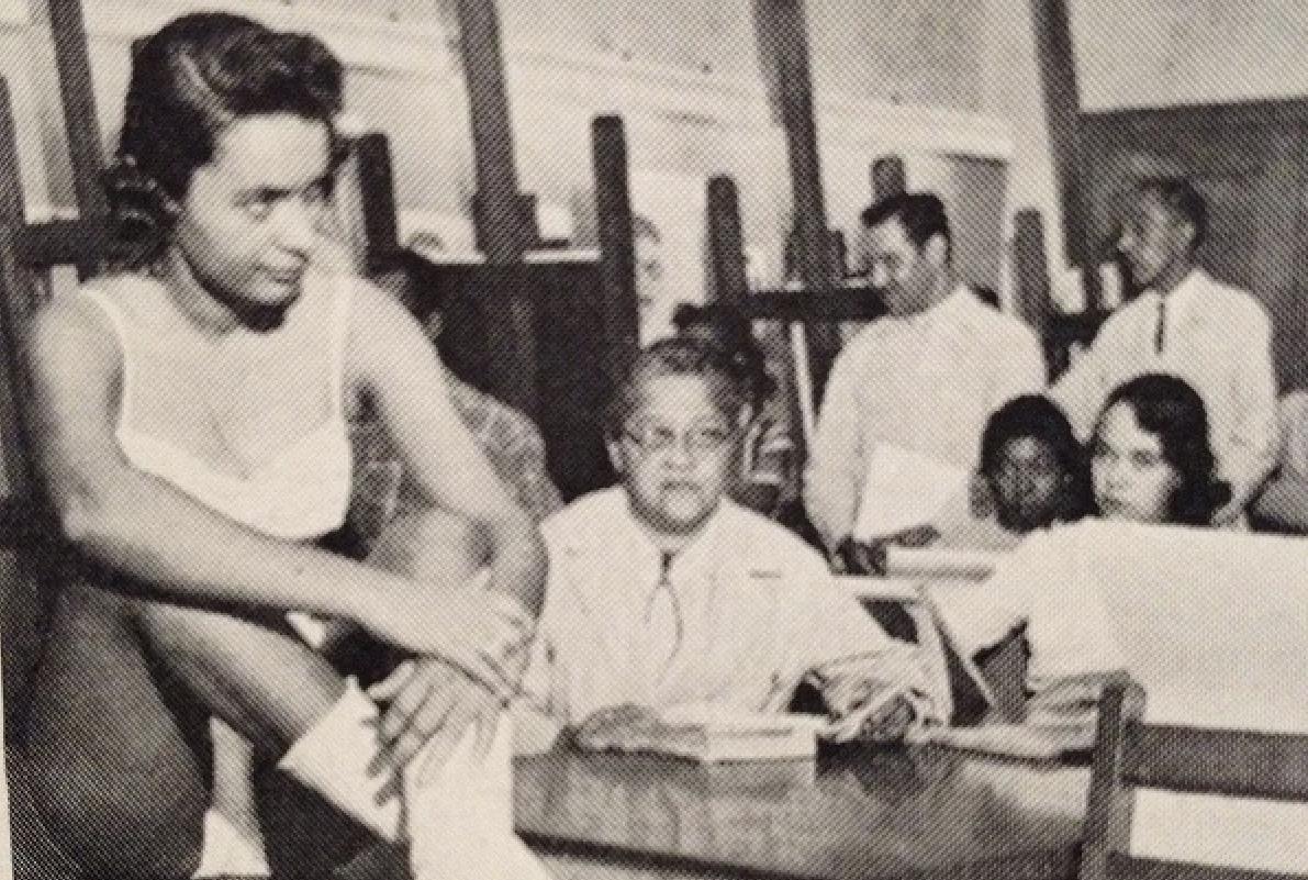 black white photo students desk teacher
